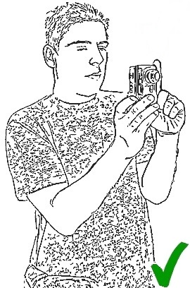 3-1-holding_compact_camera5