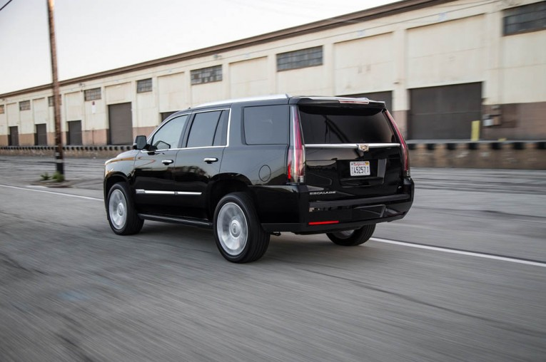 2015-cadillac-escalade-platinum-rear-three-quarter-in-motion